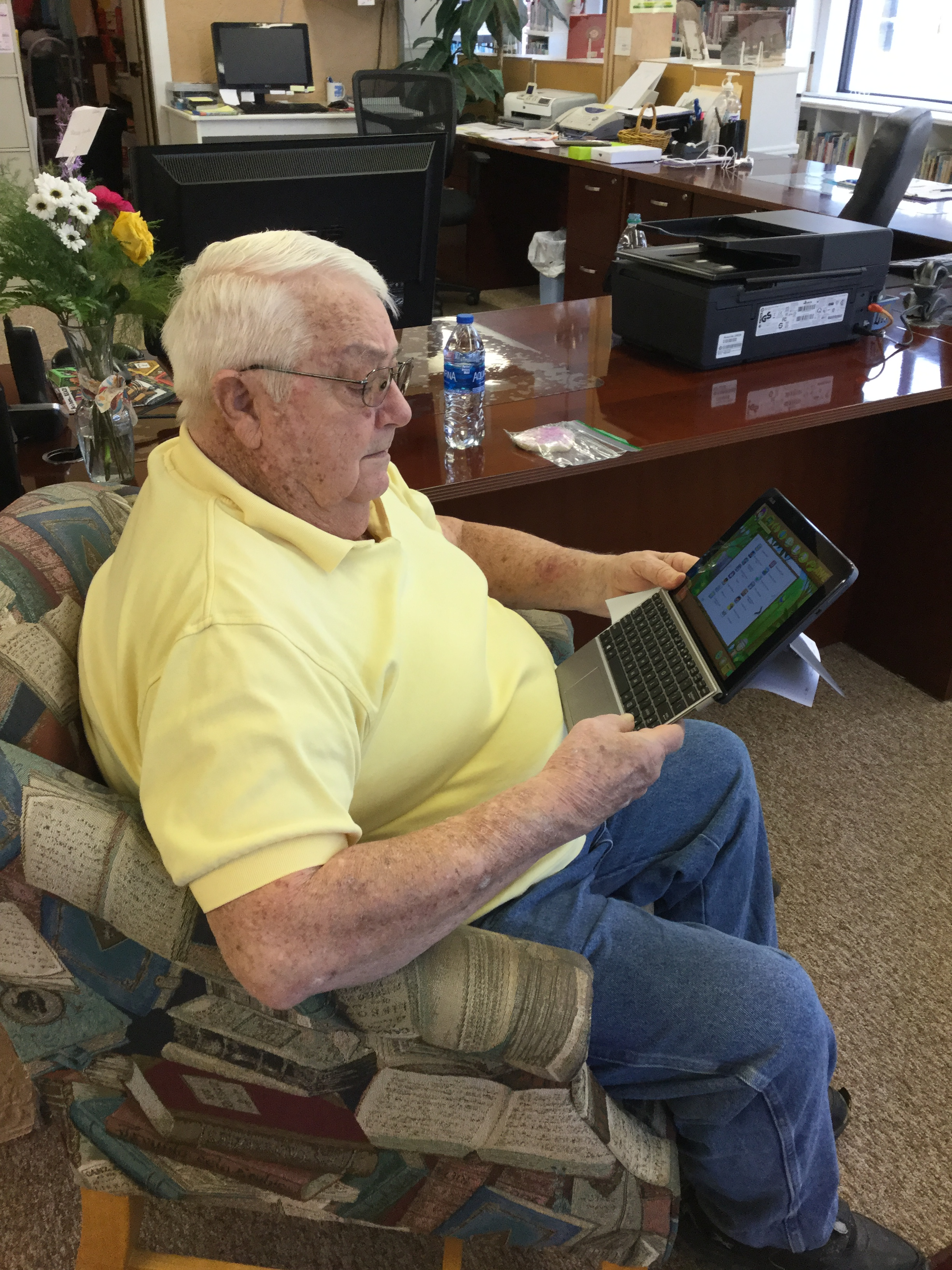 senior gentleman using a tablet to find info