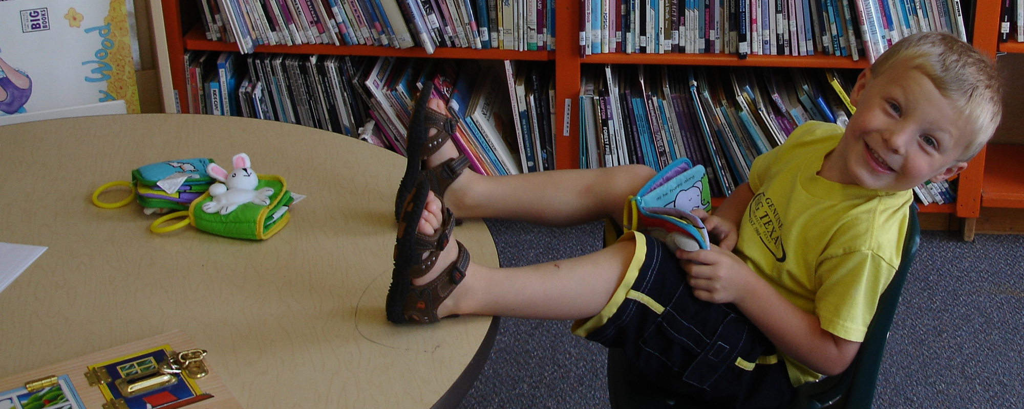 cute kid kickin back with a book